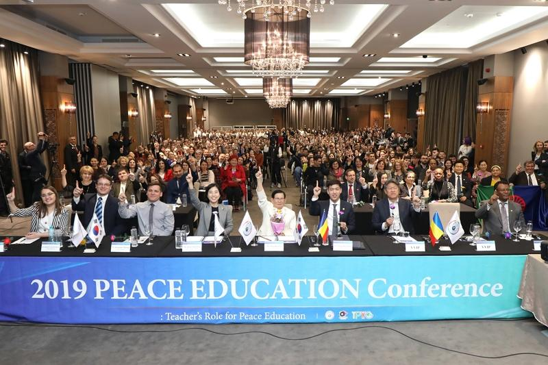 Participants shouting out We Are One at the 2019 Peace Education Conference